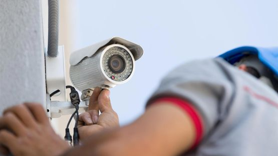 A cctv system that system that is being installed on an external wall